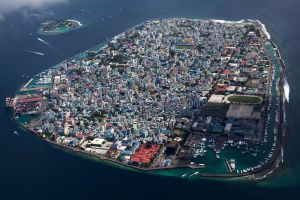 Rising sea levels threaten island and coastal communities, from the Maldives (above) to Monterey Bay. Photo courtesy Géo.